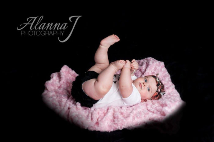 Darling baby photo on black background.