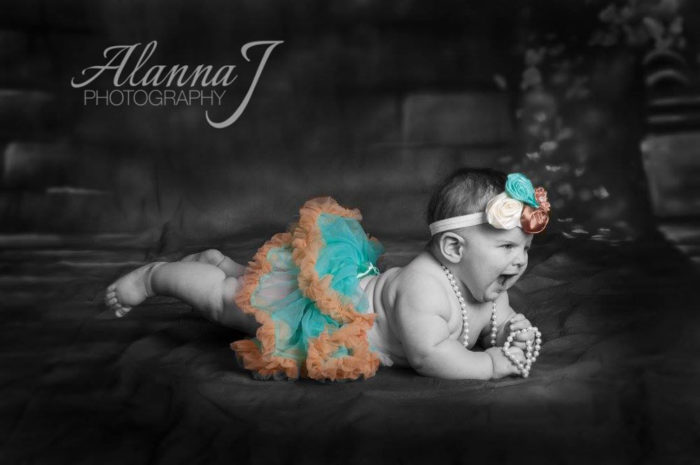 Baby screaming with a tutu on
